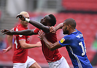 4th July 2020; Ashton Gate Stadium, Bristol, England; English Football League Championship Football, Bristol City versus Cardiff City; Curtis Nelson of Cardiff City competes for the ball with Famara Diedhiou of Bristol City
