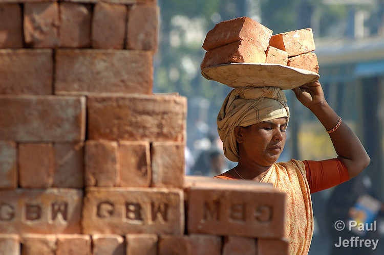 "A Dalit woman works carrying construction materials at a building site in Bangalore. In India's maze of caste and class, it's often these ""untouchable"" women who do the dirtiest jobs."
