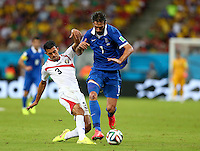 Giancarlo Gonzalez of Costa Rica tackles Georgios Samaras of Greece