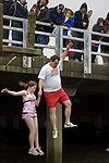 Dave Otto (R) holds his 12-year-old daughter, Madeline's hand,  as they leap into the Burley Lagoon during the 25th annual Polar Bear jump in Olalla, Washington on January 1, 2009. This was a first time leap for both of them. Jim Bryant Photo. ©2010. ALL RIGHTS RESERVED.
