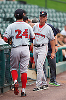 Pawtucket Red Sox pitching coach Bob Kipper (13) fist bumps Noe Ramirez (24) before a game against the Rochester Red Wings on July 1, 2015 at Frontier Field in Rochester, New York.  Rochester defeated Pawtucket 8-4.  (Mike Janes/Four Seam Images)