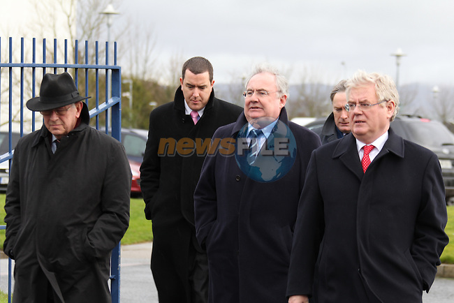 Pat Rabbit and Eamon Gilmore arriving at The State funeral of Detective Garda Adrian Donohoe taking place in Dundalk, Co Louth. Garda Donohoe was shot dead in a folded Credit Union robbery at lordship outside Dundalk on Friday evening last..Picture: Fran Caffrey/www.newsfile.ie.