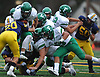 Kevin Wilson #34 of Farmingdale, second from top, leaps over a pile to pick up rushing yards during a Nassau County Conference I varsity football game against host Massapequa High School on Saturday, Sept. 22, 2018. He ran for three touchdowns. Farmingdale won by a score of 41-27.
