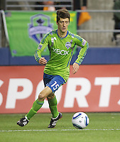 Seattle Sounders forward Alvaro Fernandez dribbles the ball during play against the L.A. Galaxy at Qwest Field in Seattle Tuesday March 15, 2011. The Galaxy won the game 1-0.