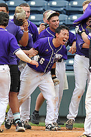 Nobu Suzuki (6) of Western Carolina is surrounded by teammates after being hit by a pitch for a bases-loaded walk-off 3-2 win against Mercer in the SoCon Tournament championship final on Sunday, May 29, 2016, at Fluor Field at the West End in Greenville, South Carolina. (Tom Priddy/Four Seam Images)