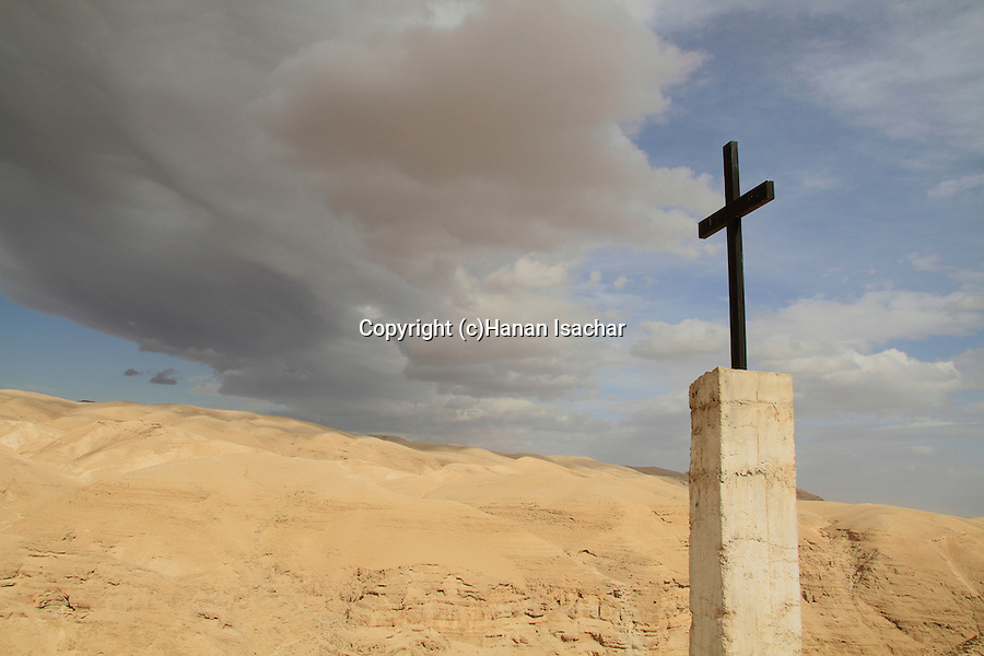 Judean Desert, a cross on the road to the Greek Orthodox St. George Monastery in Wadi Qelt