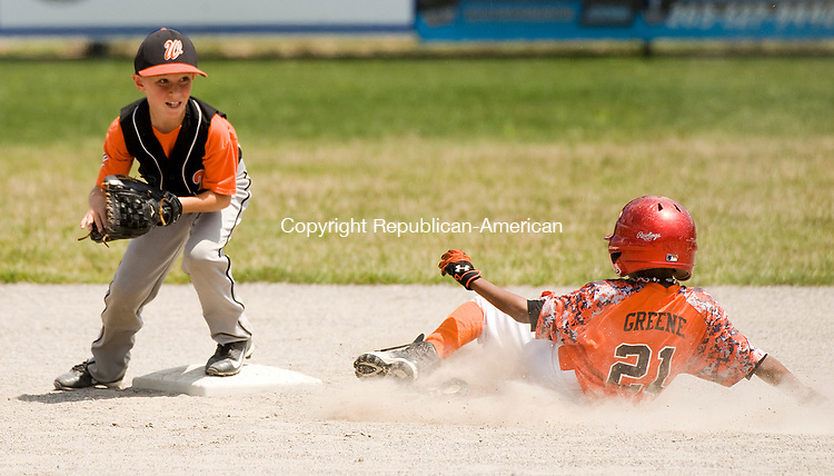WATERBURY, CT-0712117JS05--Water-Oak's Brandon Lombardo (23) gets Bonnie's Kameron Greene (21) out at a force play at second base during their consolation bracket game in the Roberto Clemente Tournament Thursday at the Waterbury PAL field. <br /> Jim Shannon Republican-American