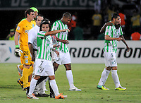 MEDELLÍN -COLOMBIA-23-04-2014. Sherman Cardenas (Der) de Atlético Nacional de Colombia celebra un gol anotado a Atlético Mineiro de Brasil durante el partido por los octavos de final de la Copa Libertadores de América 2014 jugado en el estadio Atanasio Girardot de Medellín, Colombia./ Sherman Cardenas (R) player of Atletico Nacional of Colombia celebrates a goal scored to Atletico Mineiro de Brazil during  first leg match for the knockout stages of the Copa Libertadores championship 2014 played at Atanasio Girardot stadium in Medellin, Colombia. Photo: VizzorImage/ Luis Ríos /STR