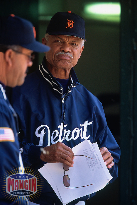 OAKLAND, CA - Detroit Tigers coach Felipe Alou watches from the dugout during a game against the Oakland Athletics at the Oakland Coliseum in Oakland, California in 2002. Photo by Brad Mangin