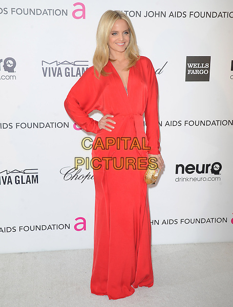 Mena Suvari.The 21st Annual Elton John AIDS Foundation Academy Awards Viewing Party held at The City of West Hollywood Park in West Hollywood, California, USA..February 24th, 2013.oscars full length red long sleeves dress gold clutch bag hand on hip.CAP/DVS.©DVS/Capital Pictures.