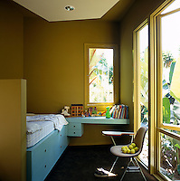 In this child's bedroom a chest-of-drawers is cleverly built into the base of the single bed