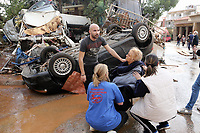 Pictured: A woman is helped away from her flooded property by local people.<br /> Re: Five people have reportedly died and severe damage caused by heavy rain and flash flooding in the area of Mandra, near Athens, Greece. Wednesday 15 November 2017