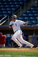 Staten Island Yankees designated hitter Miguel Flames (60) follows through on a swing during a game against the Lowell Spinners on August 22, 2018 at Richmond County Bank Ballpark in Staten Island, New York.  Staten Island defeated Lowell 10-4.  (Mike Janes/Four Seam Images)