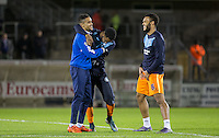 Ex Wycombe player Paris Cowan-Hall of Bristol Rovers catches up with Jason Banton of Wycombe & Aaron Holloway of Wycombe Wanderers during the Sky Bet League 2 rearranged match between Bristol Rovers and Wycombe Wanderers at the Memorial Stadium, Bristol, England on 1 December 2015. Photo by Andy Rowland.