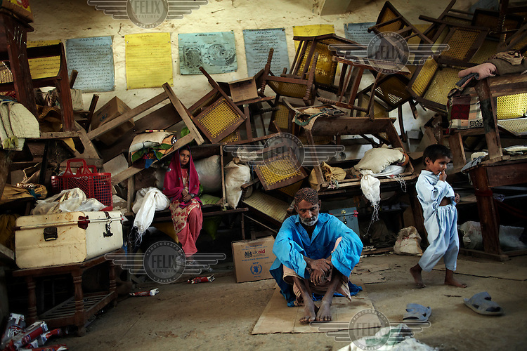 Abdul Lidef and 2 of his grandchildren pictured living in the classroom of the Government High School in Sukker, Pakistan. Schools all over Pakistan have been turned into temporary homes for those displaced by the floods.