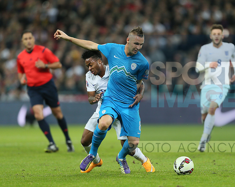 England's Raheem Sterling tussles with Jasmin Kurtic of Slovenia<br /> <br /> - International European Qualifier - England vs Slovenia- Wembley Stadium - London - England - 15th November 2014  - Picture David Klein/Sportimage