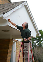 David Ferguson, maintenance worker with Cross Church, reaches Wednesday, July 29, 2020, to record measurements while working to repair an awning at Hope for the City in Fayetteville. The facility is a mission operated by the church and provides meals to community members in need as well as other essential services. Visit nwaonline.com/200730Daily/ for today's photo gallery.<br /> (NWA Democrat-Gazette/Andy Shupe)