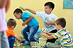 "THIS PHOTO IS AVAILABLE AS A PRINT OR FOR PERSONAL USE. CLICK ON ""ADD TO CART"" TO SEE PRICING OPTIONS.   Roma children playing in the Nasa Radost preschool in Smederevo, Serbia."