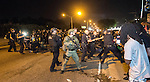 BATON ROUGE, LA -JULY 09: The Baton Rouge police rush the crowd of protesters and make several arrest before retreating fon July 9, 2016 in Baton Rouge, Louisiana. Alton Sterling was shot by a police officer in front of the Triple S Food Mart in Baton Rouge on July 5th, leading the Department of Justice to open a civil rights investigation. (Photo by Mark Wallheiser/Getty Images)