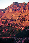 Garden Wall mountain ridge along the Continental Divide glows in evening at sunset with Going to the Sun Road in Glacier National Park Montana USA