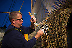 Commercial fisherman working with nets