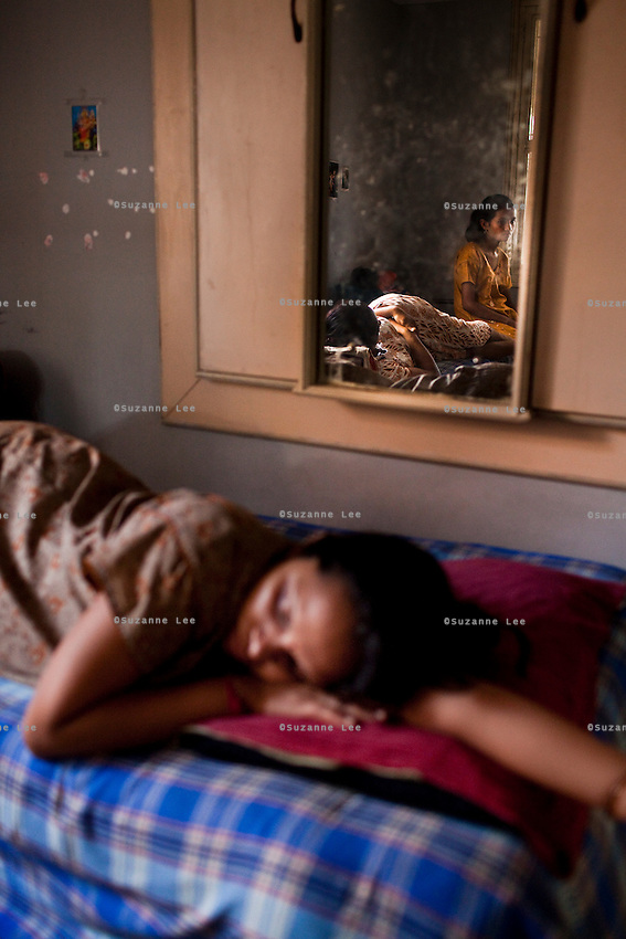 Women lounge around the surrogate house for their entire term of pregnancy while posters of babies and religious symbols adorn the walls together with calendars that they often use to count their days to the end of their terms. The women come to the house with just a small bag of clothes as everything else is provided for in the house...The Akanksha Infertility Clinic in Anand, Gujarat, India, is known internationally for its surrogacy program and currently has over a hundred surrogate mothers pregnant in their environmentally controlled surrogate houses.