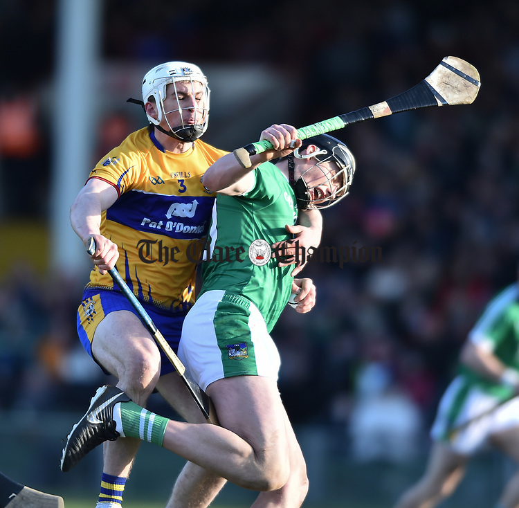 Conor Cleary of  Clare  in action against Gearoid Hegarty of  Limerick during their NHL quarter final at the Gaelic Grounds. Photograph by John Kelly.