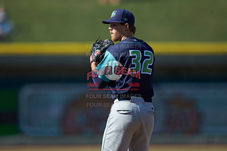 Lynchburg Hillcats relief pitcher Jonathan Teaney (32) looks to his catcher for the sign against the Winston-Salem Rayados at BB&T Ballpark on June 23, 2019 in Winston-Salem, North Carolina. The Hillcats defeated the Rayados 12-9 in 11 innings. (Brian Westerholt/Four Seam Images)