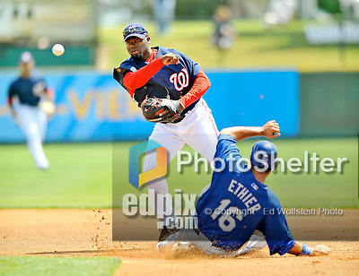 15 March 2008: Washington Nationals' second baseman Cristian Guzman doubles off Los Angeles Dodgers' Andre Ethier (16) during a Spring Training at Space Coast Stadium, in Viera, Florida...Mandatory Photo Credit: Ed Wolfstein Photo