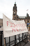 demonstrators sign outside Sheffield Town Hall near the Liberal Democrat party Conference in Sheffield Friday Afternoon.11 March 2011.Images © Paul David Drabble