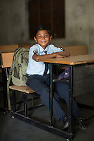 The son of a cotton farmer, Sandeep Patodhya, aged 9, sits in his classroom in the Vasudha Vidya Vihar school in Khargone, Madhya Pradesh, India on 12 November 2014. Sandeep ambition is to be a Police officer. Even though his father is not a Fairtrade farmer, Sandeep benefits from the Vasudha Vidya Vihar school that was built using the Fairtrade Premium. Photo by Suzanne Lee for Fairtrade