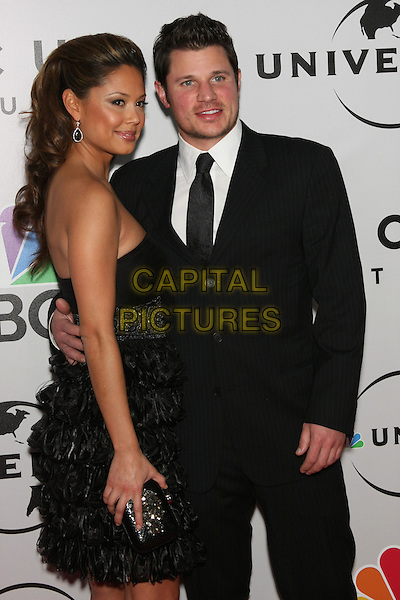 VANESSA MINNILLO & NICK LACHEY .The 2010 NBC, Universal Pictures & Focus Features' Annual Golden Globes After-Party at the Beverly Hilton, Beverly Hills, CA, USA.                                                                         January 17th, 2010.globes half 3/4 length black suit strapless dress clutch bag couple layers layered frills .CAP/LNC/AM.©Alba Montes/LNC/Capital Pictures