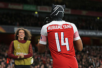 Pierre-Emerick Aubameyang of Arsenal celebrates scoring their third goal by wearing a mask as he runs towards substitute, Matteo Guendouzi during during Arsenal vs Rennes, UEFA Europa League Football at the Emirates Stadium on 14th March 2019