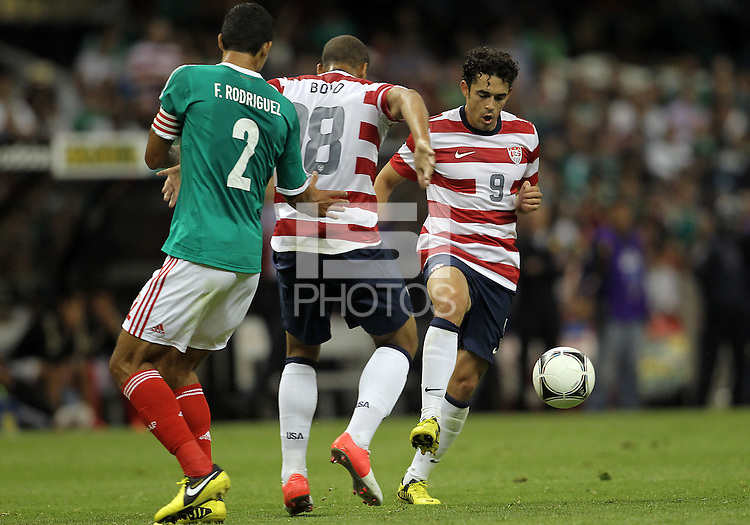 MEXICO CITY, MEXICO - AUGUST 15, 2012:  Herculez Gomez (9) and Terrence Boyd (18) of the USA MNT block Fransisco (Maza) Javier Rodriguez (2) of  Mexico during an international friendly match at Azteca Stadium, in Mexico City, Mexico on August 15. USA won 1-0.