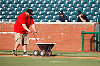 A Chattanooga Lookouts ground crew member prepares the field before the game against the Montgomery biscuits at AT&T Field on May 23, 2018 in Chattanooga, Tennessee. (Andy Mitchell/Four Seam Images)