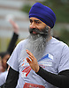 Parmjit Singh, 47, of East Elmhurst, waves to an onlook before the start of the 2016 Long Island Marathon Weekend's 5K race on Charles Lindbergh Boulevard on Saturday, Apr. 30, 2016.