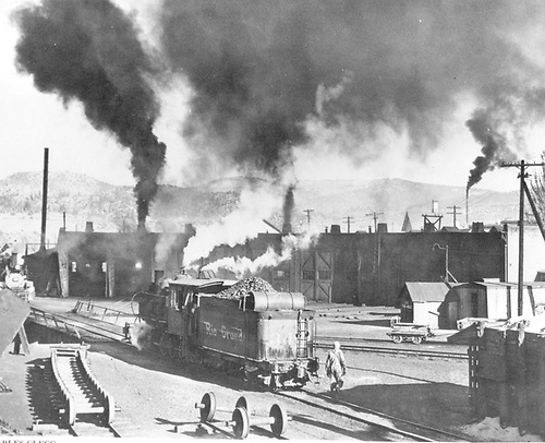 #345 approaching Durango turntable. All nine roundhouse stalls in view. Wheel track.<br /> D&amp;RGW  Durango, CO Taken by Clegg, Charles M.