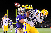 Sept. 5, 2009; Seattle, WA, USA; LSU Tigers linebacker (56) Perry Riley breaks up a pass intended for Washington Huskies tailback (23) Johri Fogerson at Husky Stadium. LSU defeated Washington 31-23. Mandatory Credit: Mark J. Rebilas-