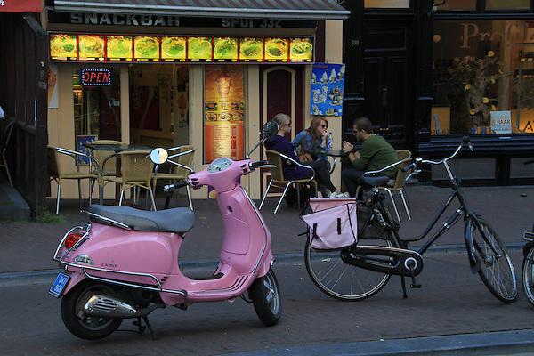 Pink motor scooter and Dutch cafe, Amsterdam, Holland, Netherlands.