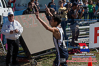 Marquette senior Noah Kauppila raises his arms in victory while capturing the Class 4 Missouri High School State Cross Country title and breaking Matt Tegenkamp's State Meet record.