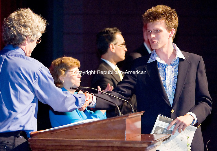 WATERBURY, CT- 27 MAY 2008- 052708JT03- <br /> Music student Liam Pierce shakes hands with Richard Gard, associate music professor, as Pierce is awarded with the Roy T. D'Arcy Memorial Musician of the Year Award for excellence in music during Naugatuck Valley Community College's Honors Night on Tuesday in Waterbury. In the background are NVCC Executive Dean Patricia Bouffard and NVCC Interim President Wilfredo Nieves.<br /> Josalee Thrift / Republican-American