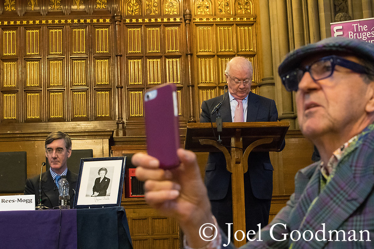 © Joel Goodman - 07973 332324 . 02/10/2017. Manchester, UK. JACOB REES-MOGG with a framed portrait of Margaret Thatcher at a fringe , listens to audience questions during a right-wing Bruges Group event at Manchester Town Hall during the second day of the Conservative Party Conference at the Manchester Central Convention Centre . Photo credit : Joel Goodman