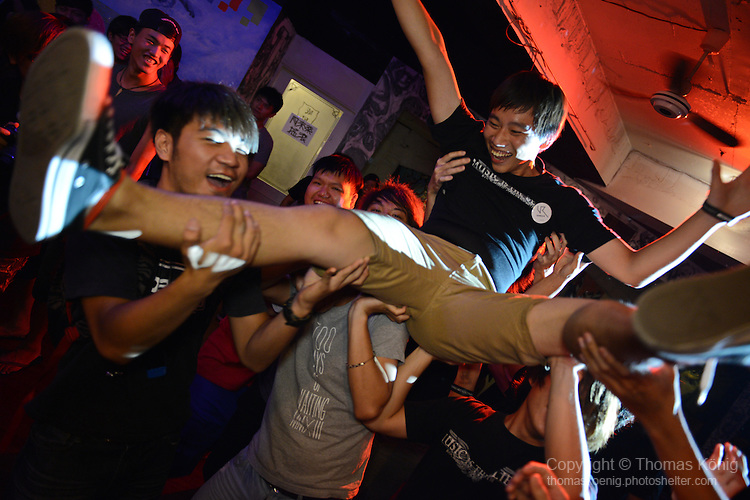 Rocks, Kaohsiung -- Crowd-surfing during a performance of the Taiwanese metalcore band BREAK POINT at the Rocks.