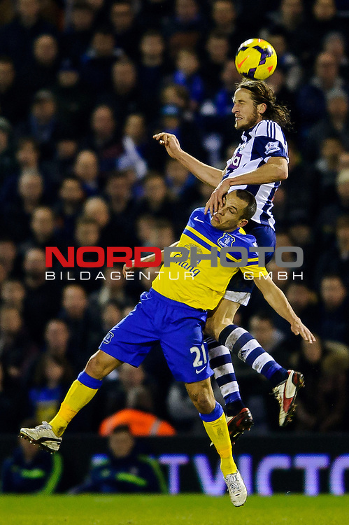 Everton Midfielder Leon Osman (ENG) takes a hand to the face from West Brom Defender Jonas Olsson as they compete in the air -  - 20/01/2014 - SPORT - FOOTBALL - The Hawthorns Stadium - West Bromwich Albion v Everton - Barclays Premier League.<br /> Foto nph / Meredith<br /> <br /> ***** OUT OF UK *****