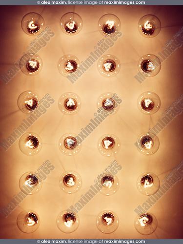 Group of lit incandescent tungsten light bulbs