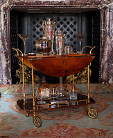 BNPS.co.uk (01202 558833)<br /> Pic: PhilYeomans/BNPS<br /> <br /> Stylish cocktail cabinet.<br /> <br /> Let's Misbehave - A fascinating insight into the heady world of the upper classes in the roaring twenties has opened at Blenheim Palace.<br /> <br /> The 9th Duke of Marlborough and his second wife, American intellectual Gladys Deacon, were lavish hosts at the baroque Oxfordshire Palace.<br /> <br /> Their frequent house parties in a time of great social, artistic and political change were attended by friends as diverse as Winston Churchill, Edith Sitwell, Jacob Epstein and Bloomsbury set founders Lytton Strachey and Virginia Woolf.<br /> <br /> The exhibition showcases their lavish lifestyles in a series of scenes within the Palaces elegant State Rooms.<br /> <br /> Actors portraying the leading characters interact with the visiting public to give a flavour of the famously decadent decade.