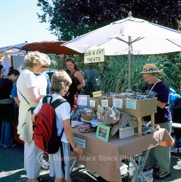 Artisan selling Dog and Cat Treats at the Saturday Market in Ganges, on Saltspring Island, in the Southern Gulf Islands of British Columbia, Canada