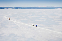 Martin Buser and Zack Steer<br /> run on frozen Norton Bay on their way to Koyuk during the 2010 Iditarod