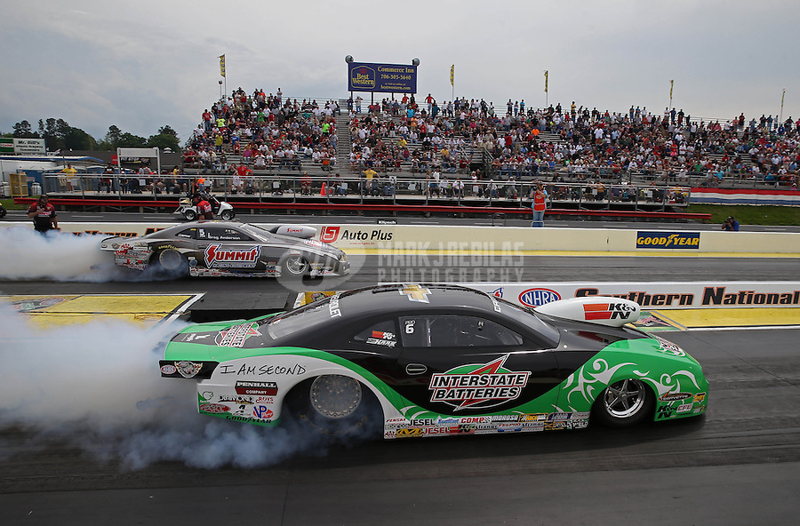 May 11, 2013; Commerce, GA, USA: NHRA pro stock driver Mike Edwards (near) alongside Greg Anderson during the Southern Nationals at Atlanta Dragway. Mandatory Credit: Mark J. Rebilas-