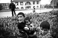 "Nagorny-Karabach, 18.05.2011, Shushi. Ein paar Jungs messen ihre Kr?fte auf einem Spielplatz in Schuschi. ""The Twentieth Spring"" - ein Portrait der s¸dkaukasischen Stadt Schuschi, 20 Jahre nach der Eroberung der Stadt durch armenische K?mpfer 1992 im B¸gerkrieg um die Unabh?ngigkeit Nagorny-Karabachs (1991-1994). Boys contest their physical power in the streets of Shushi. ""The Twentieth Spring"" - A portrait of Shushi, a south caucasian town 20 years after its ""Liberation"" by armenian fighters during the civil war for independence of Nagorny-Karabakh (1991-1994)..Garçons confrontent leur force physique dans les rues de Chouchi.""Le Vingtieme Anniversaire"" - Un portrait de Chouchi, une ville du Caucase du Sud 20 ans après sa «libération» par les combattants arméniens pendant la guerre civile pour l'indépendance du Haut-Karabakh (1991-1994).. © Timo Vogt/Est&Ost, NO MODEL RELEASE !!"